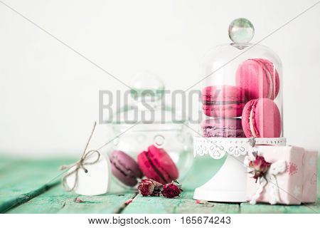 French Macaroons Cookies And Gift Box On A Wooden Background. Mothers Day Or Valentines Day Greeting