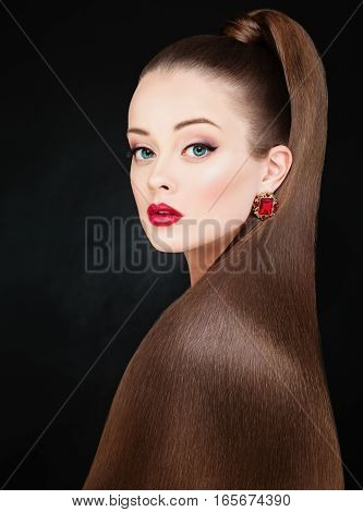 Beauty Fashion Portrait of Beautiful Woman with Long Healthy Hair on Black Background