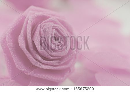 Pink rose fabric flower and small hart on white background for Valentine festival. Retro style color effect