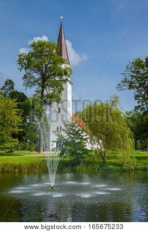 Lutheran Church Of St Berthold And Pond In The Foreground. Sigulda, Latvia.