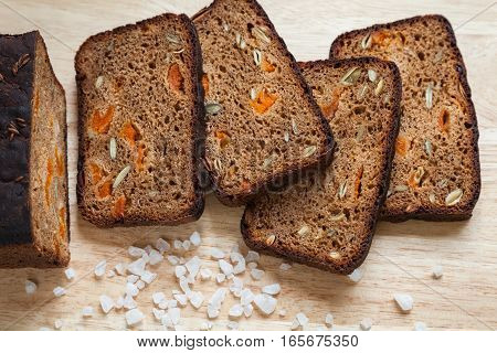 Healthy homemade bread. Slices of whole grain rye bread with pumpkin seeds and dried apricots