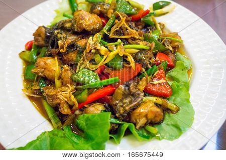 Fried Frog Meat With Green And Red Peppers