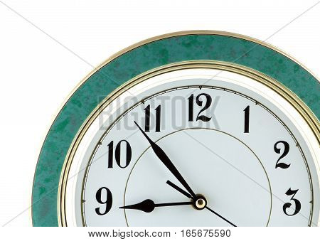 Fragment of big wall clock with green case shows almost nine o'clock isolated on white close up