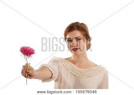 A young elegant lady offering a pink flower