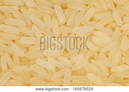 Parboiled medium-grain rice details background. Rice closeup