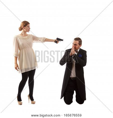A lady holding a handgun at a man in a suit