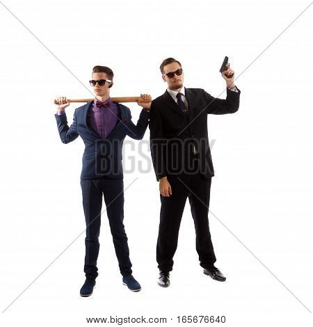 A couple of well dressed man holding weapons