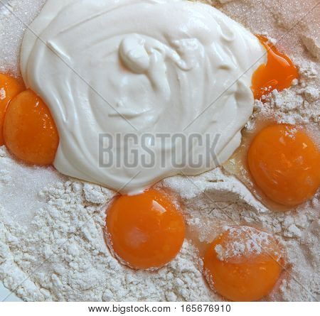 Egg yolks flour sugar and sour cream as a dough ingredients