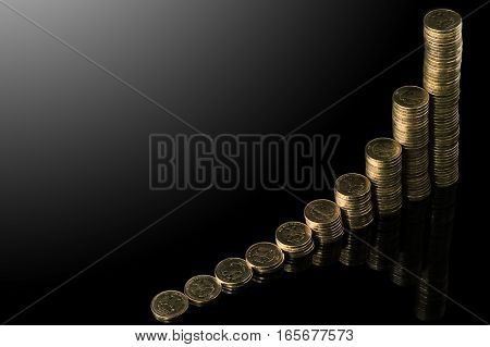 Isolated Stack Of Coins Over Black Background