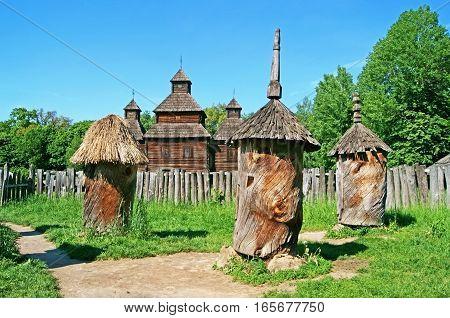 Antique wooden chapel and beehive, Pirogovo, Kyiv, Ukraine