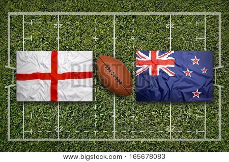 England vs. New Zealand flags on green rugby field, 3d illustration