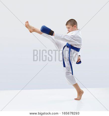 In karategi athlete is beating kick leg