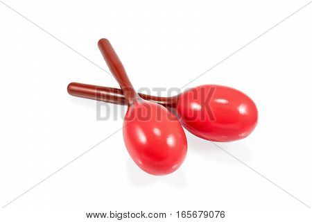 Two beautiful red Mexican maracas lie on each other isolated on white background