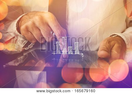 Businessman with tablet computer and diagram infographics visual aid for business efficiency