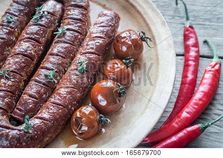 Roasted chorizo with cherry tomatoes on the plate