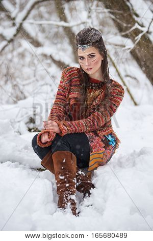 Portrait Of Native Indian Woman With Traditional Makeup And Hairstyle In Snowy Winter. Beautiful Gir