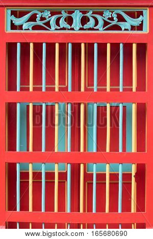 window security grate painted in bright colour in El Jardin Colombia