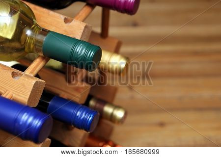 Various Red And White Wine Bottles In A Wooden Wine Rack With Space For Text