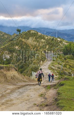 Andean Natives Walking At Road Quilotoa Ecuador