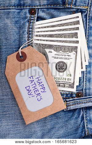 Father's Day tag and dollars. Greeting label on jeans pocket. Pleasant present for dad.