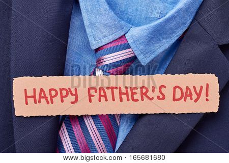 Greeting card on formal clothes. Happy Father's Day. Elegance in every detail.