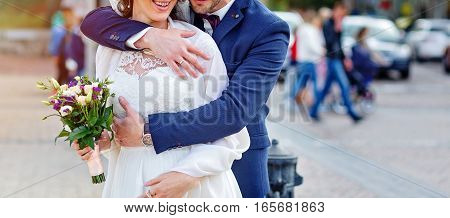 Bride and groom on their wedding day outdoors