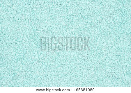 Teal pile terry cloth fabric background with copy space