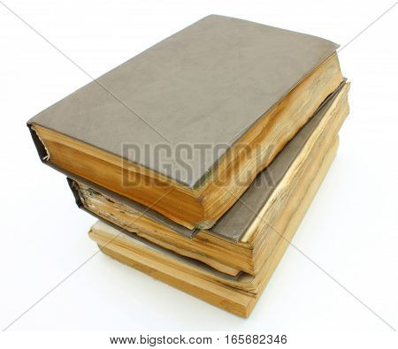 Pile from old mouldy books on a white background