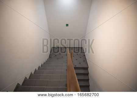 Back door staircase with exit sign for emergency evacaution