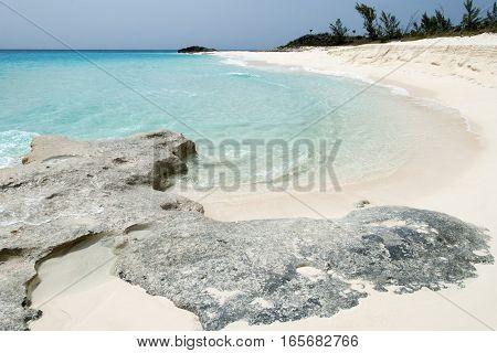The view of a sandy shore on uninhabited Half Moon Cay island (Bahamas).