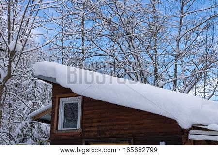 winter hut in the forest of austria alps