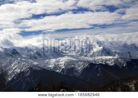 View On Snow Mountains And Sunlight Cloudy Sky At Winter Evening