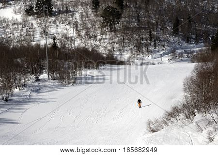 Skier On Ski Slope At Sunny Winter Day