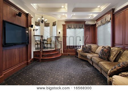 Media room in luxury home with step up cove