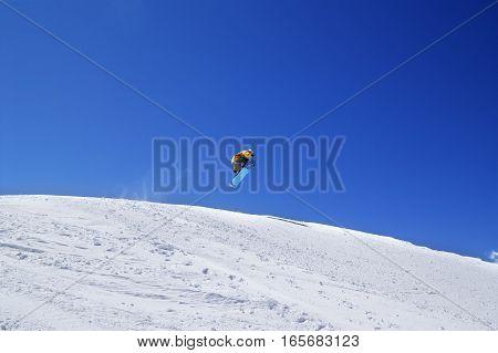 Snowboarder Jump In Terrain Park At Ski Resort On Sun Day
