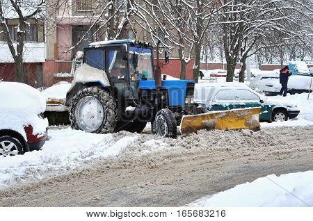 Photo of tractor clears snow in courtyard