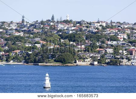 The view of Sydney's Eastern residential suburb woth a lighthouse on a top of a hill (New South Wales).