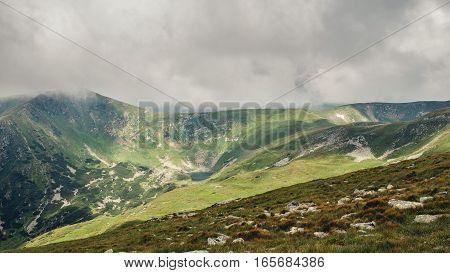Picturesque and dramatic Carpathian mountains under huge rain clouds nature landscape in summer Ukraine