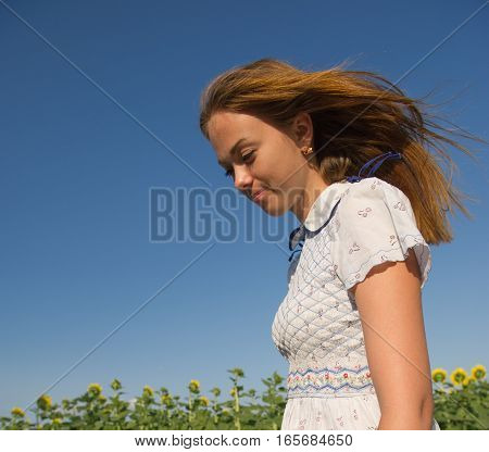 portrait of a pretty girl and her hair fluttering in the wind
