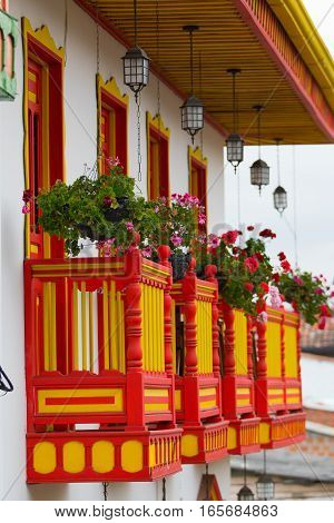 brightly coloured colonial style balconies in Salento Colombia