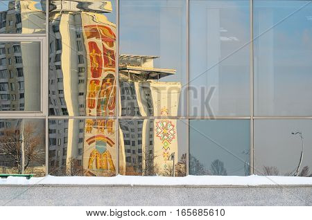 Distorted Reflections of buildings in the city in the stained-glass window. Painted building in reflecting windows