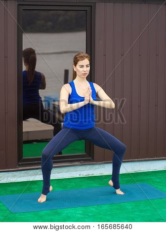 Young Woman Practicing Advanced Yoga Fitness Workout 23