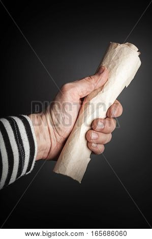 Strong Sailor Hand Holds Rolled Old Paper