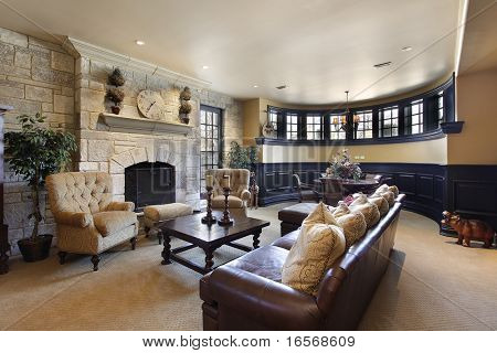 Basement in luxury home with stone fireplace poster