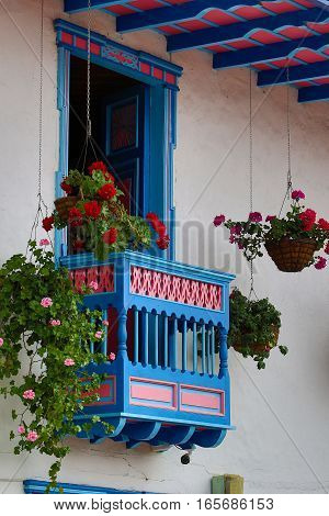 colourful wooden colonial style balcony decorated with flowers in Salento Colombia