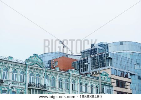 construction of multi-storey office building on the sky background.