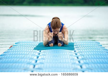 Young Woman Doing Yoga Exercise On Mat 26