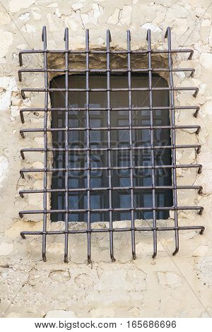 foreground of the latticed window of a castle