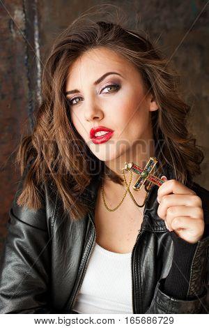 Portrait of a girl jewelry cross red lips