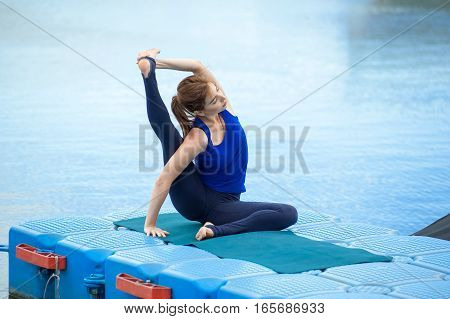 Young Woman Practicing Advanced Yoga Fitness Workout 28